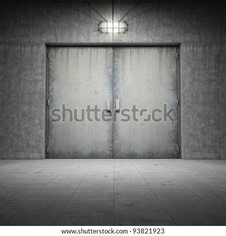 Industrial building made of grungy concrete with door
