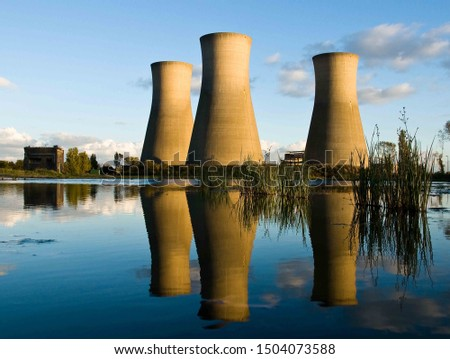 Industrial buildings reflected in clear water