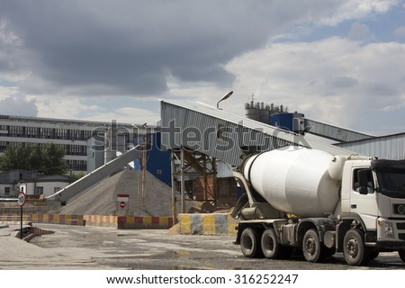 Industrial Cement Processing Plant. the foreground of a truck mixer