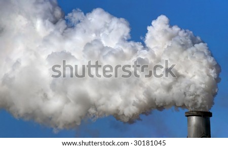 Industrial chimney exhausting smokes into the atmosphere.