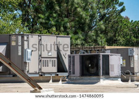 Old industrial roof cooling compressor Images and Stock