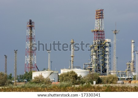 Industrial complex of an oil refinery with pipes and towers