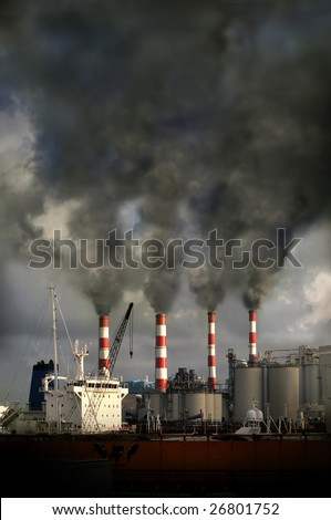 Industrial complex with smokestacks blowing pollution into the air