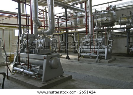 industrial compressors and pipe work in factory