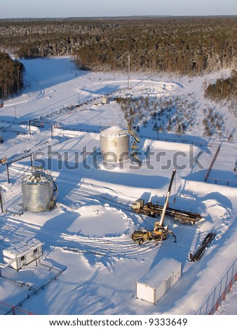 Industrial construction and mechanism. Work of oil industry. Mounting of pipeline in wild Siberian taiga.