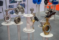 Industrial construction piping system component. Butterfly valve, double regulating valve and plug valve