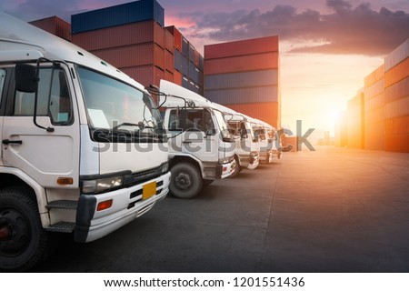 Industrial Container yard with forklift working in the morning for logistic import export background