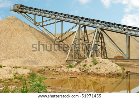 Industrial conveyor belt at gravel extraction pit