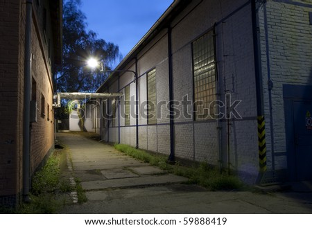 Industrial corridor at night - while vintage building