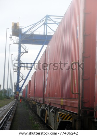 Industrial crane and train in Fog
