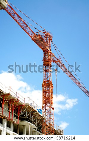 industrial  crane  multi level building construction with blue sky clouds background