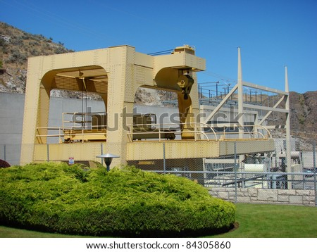 industrial crane on grand coulee dam - stock photo