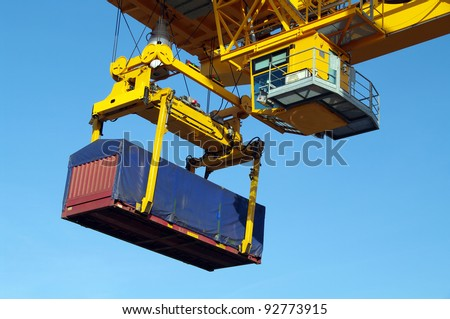 Industrial crane with flat containers in port