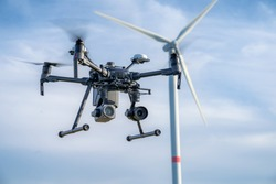 Industrial drone equipped with two cameras for inspection of rotor blades on wind turbines
