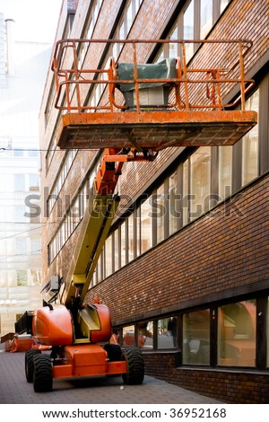 Industrial elevated crane platform in front of an office building