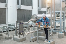 Industrial engineer inspection checking measure position of piping and valve before connecting or welding fixed of cooling water system in the factory