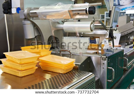 Industrial equipment for food packaging in factory #737732704