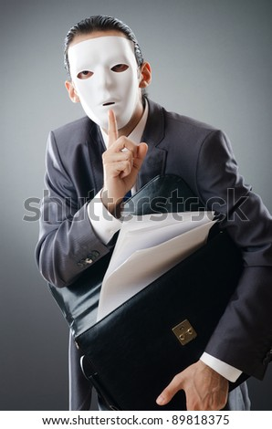 Industrial espionate concept with masked businessman