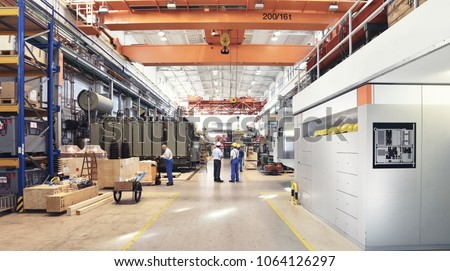 industrial factory in mechanical engineering for the manufacture of transformers - interior of a production hall  #1064126297