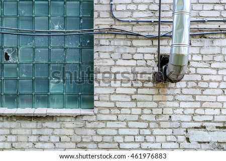 Industrial Flue Pipe Out Of The Wall With A Window Factory Building #461976883