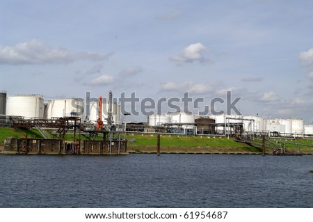 Industrial fuel storage tanks at shipping port
