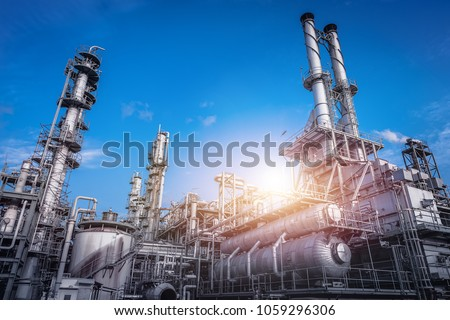 Industrial furnace and heat exchanger cracking hydrocarbons in factory on blue sky background, Close up of equipment in petrochemical plant