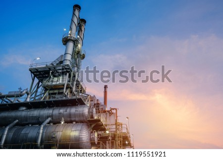Industrial furnace and heat exchanger cracking hydrocarbons in factory on blue sky sunset background, Close up of equipment in petrochemical plant at evening