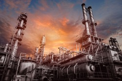 Industrial furnace and heat exchanger cracking hydrocarbons in factory on sky sunset background, Close up of equipment in petrochemical plant