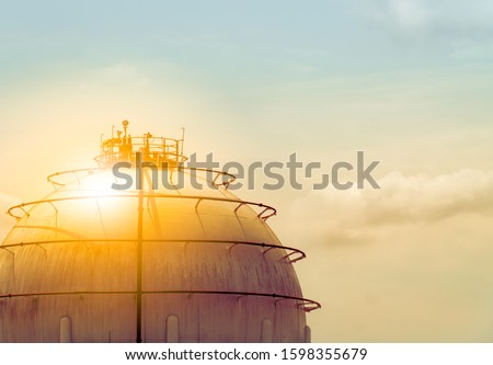 Industrial gas storage tank. LNG or liquefied natural gas storage tank. Spherical gas tank in petroleum refinery.Natural gas storage industry and global market consumption