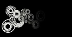 Industrial gears and cogs on black background. Copy space.