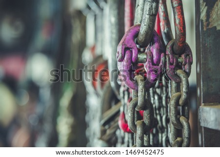 Industrial Grade Support Chains on a Rack. Heavy Duty Equipment.