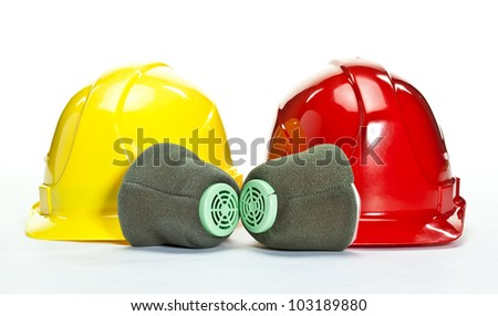 Industrial hardhats and respirators on white background; protective devices for workers