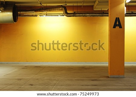 Industrial interior painted in yellow - stock photo