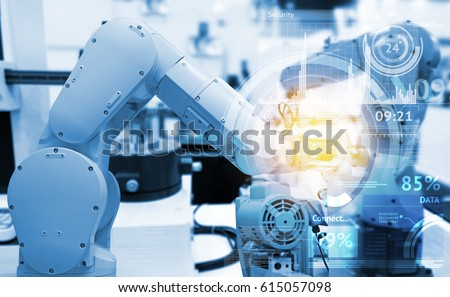 Industrial internet of things and industry 4.0 concept. Abstract blue background of technology graphic and automation wireless control robotic machine in smart factory with flare light effect.