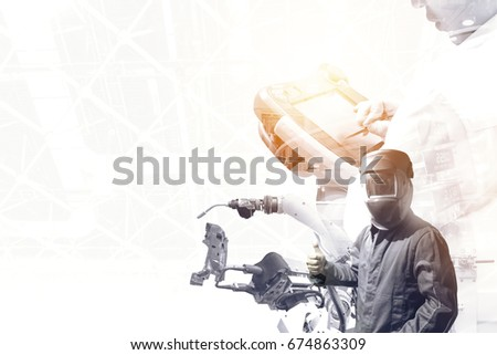 Industrial internet of things , disruption technology , industry 4.0 concept.Double exposure of automate wireless robot arm and man using controller for control and monitoring system in smart factory.