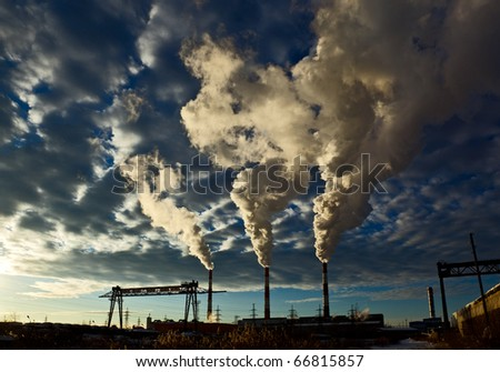 industrial  landscape, sky with clouds, the smoke from the chimneys of thermal power plants