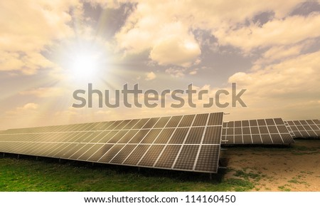 Industrial landscape with fotovoltaic power plant. Environmental concept - damaged landscape.