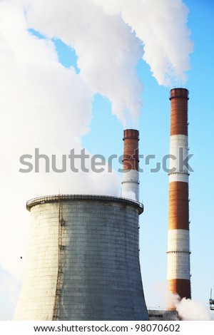Industrial landscape with pipes against the blue sky