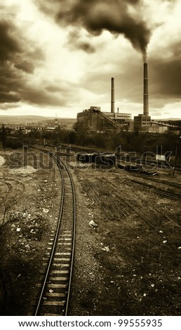 industrial landscape with railroad and toxic fumes coming from high towers polluting the air