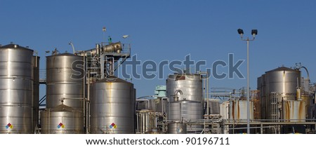 Industrial landscape with steel reservoir towers