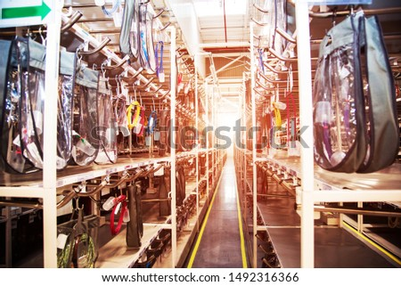 Industrial landscape with wire racks in a modern plant for the production of electric wiring for automobiles. Logistics #1492316366