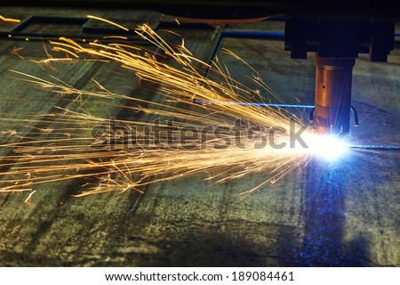 Industrial laser or plasma cutting processing manufacture technology of flat sheet metal steel material with sparks