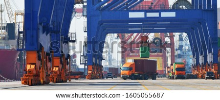 Industrial logistics and transportation of truck in Container yard for logistic and Cargo business in the shipping port,banner side