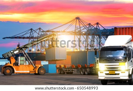 Industrial logistics Containers shipping and forklift handling container box loading and transportation of Container truck in ship port for logistic and Cargo business plane.