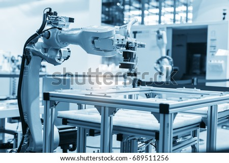 industrial machine and factory robot arm,Smart factory industry 4.0 concept.