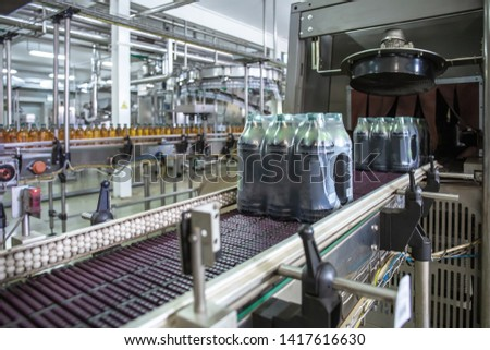 Industrial machine for packaging of beverage plastic bottles at plant for production of beverages, juices and drinking water. #1417616630