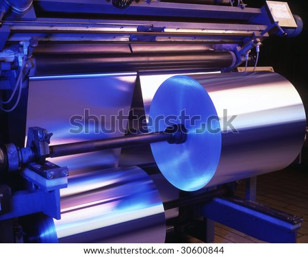 industrial machine with aluminum foil - stock photo