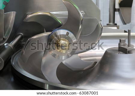 Industrial meat grinder close up - mincing-machine