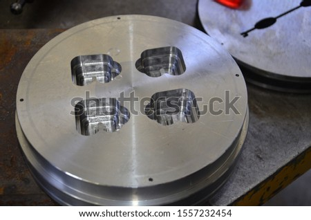 Industrial metal mold blank. Metalworking. CNC milling technology. Mechanical engineering. Mechanical engineering and metalworking industry. Indoors horizontal image.