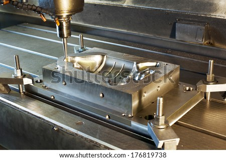 Industrial metal mold milling. Metalworking. Milling and drilling industry. CNC technology.